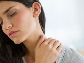 USA, New Jersey, Jersey City, woman suffering from neck pain